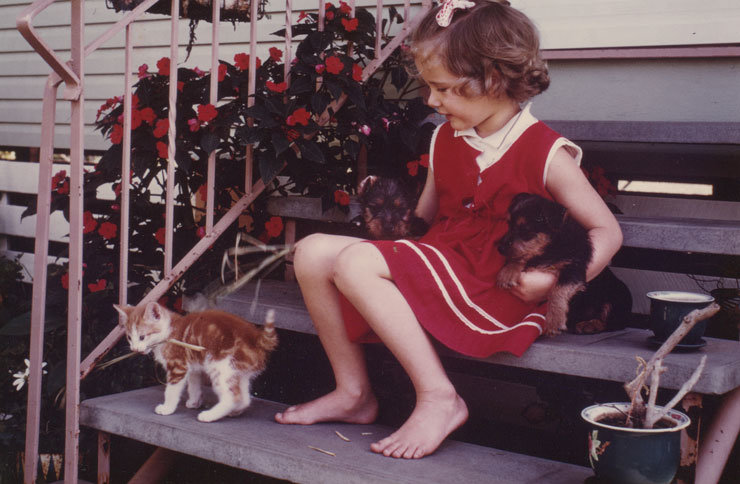 Belinda, aged 5, with a firm grip on two puppies, in the company of a ginger kitten named Pineapple. How patient must my dad have been to get this one?